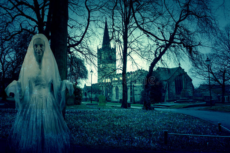 Scary Church Graveyard with Ghost. Photo of a Scary Church Graveyard with Ghost royalty free stock image