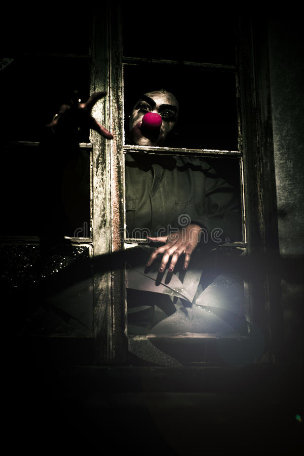 Download Scary Clown Clawing Window stock photo. Image of spooky - 17743746