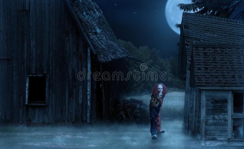 Scary clown in an eerie setting holds his finger to his mouth. A scary clown in an eerie setting holds his finger to his mouth royalty free stock images