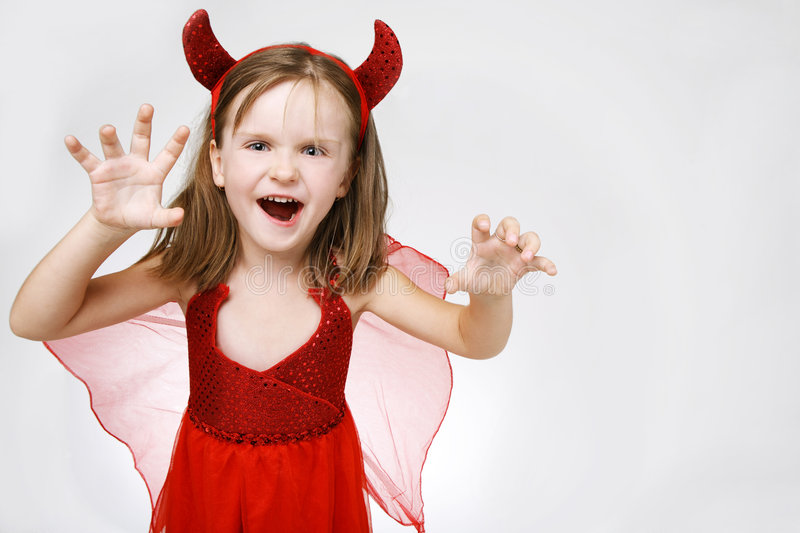 Scary cute little girl. royalty free stock images