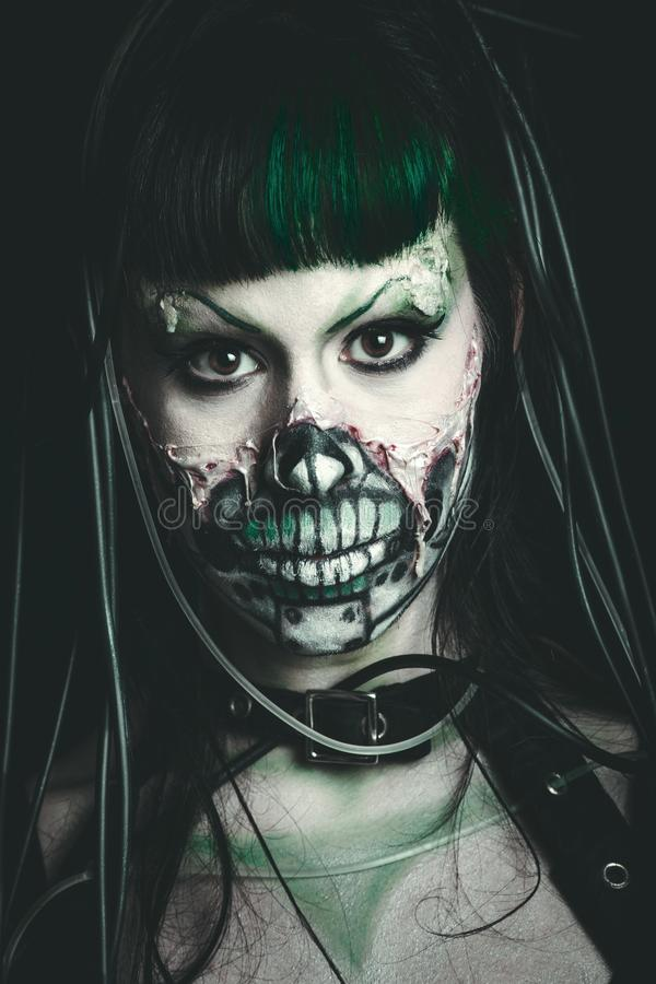 Scary cyber skeleton woman studio shot stock images