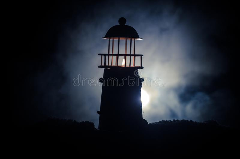Scary dark ominous lighthouse behind a red fire background. Lighthouse at dusk/ Sunset Light House/ Light house at sunset. Decorat. Scary dark ominous lighthouse stock image