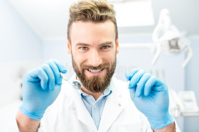 Scary dentist looking at the camera stock image