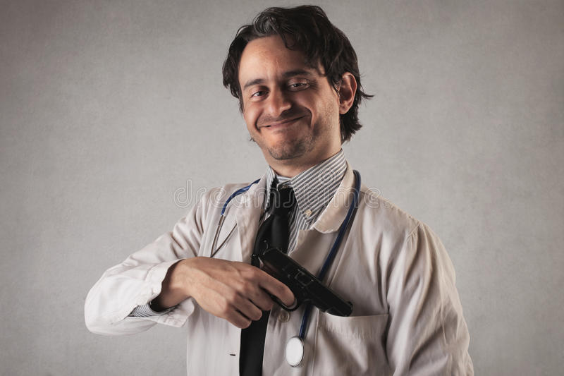Download Scary Doctor With A Gun Coming Out Of His Pocket Stock Photo - Image of opportunity, caucasian: 39505074