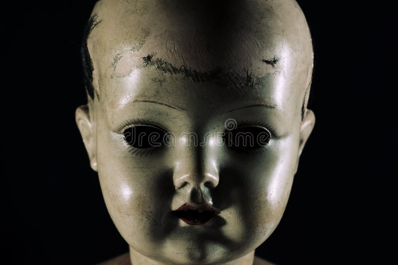 Scary doll face stock photography