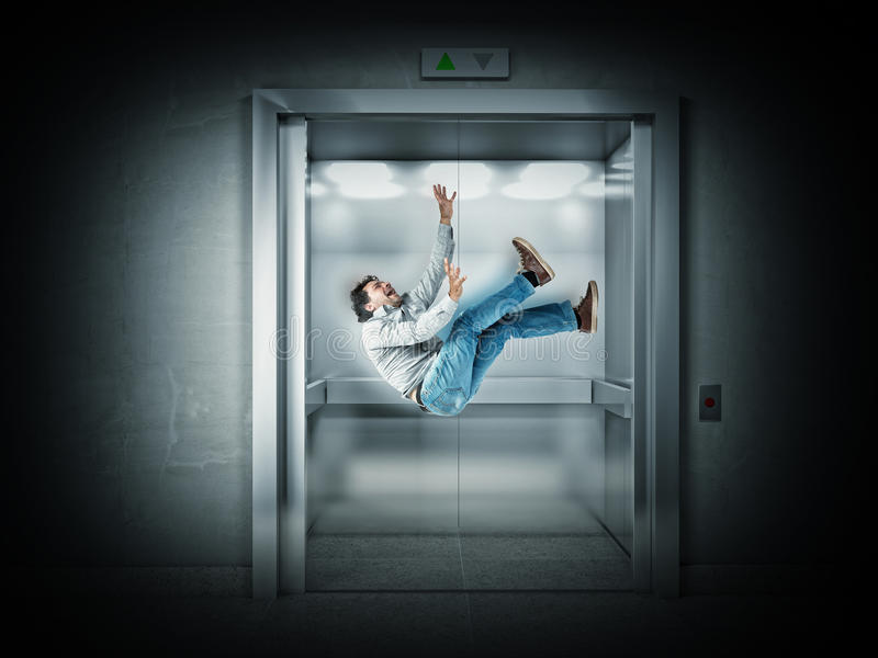 Scary elevator. Falling man and 3d elevator stock photos