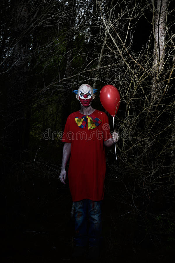 Download Scary Evil Clown In The Woods At Night Stock Photo - Image: 85290092