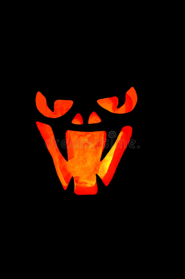 Scary Face. Scary looking Jackolantern face lit up, glowing in the dark, dark night stock images