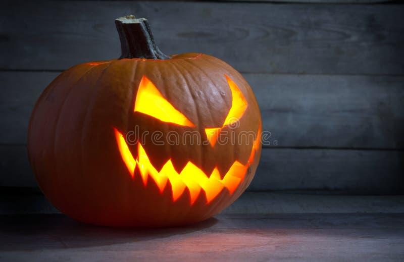 Scary face lack o lantern on wooden dark background stock photo