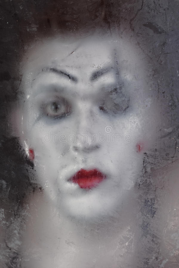 Scary Face Screaming Mime For Murky Glass Stock Images