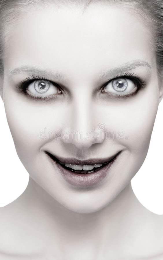 Scary female face with helloween horror grimm. Scary female face with halloween horror grimm close-up stock photography