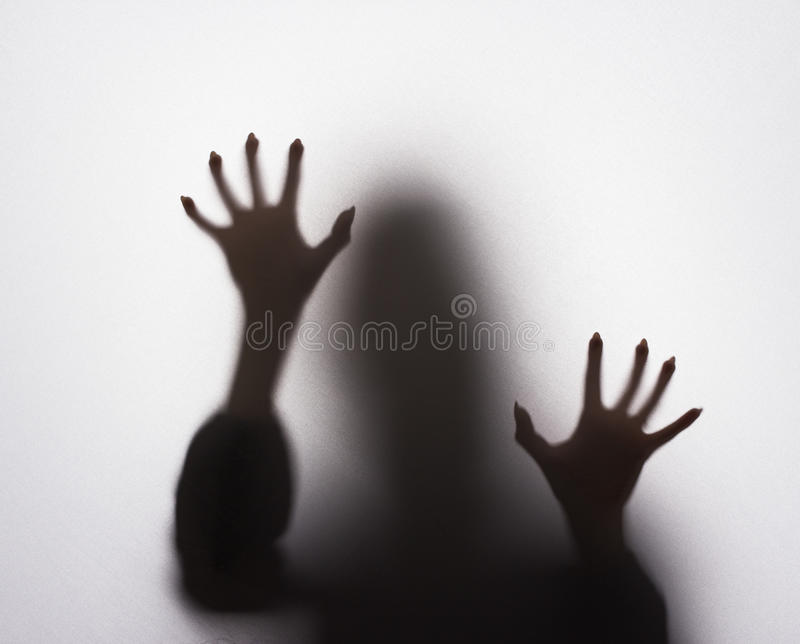 Scary female silhouette stock images