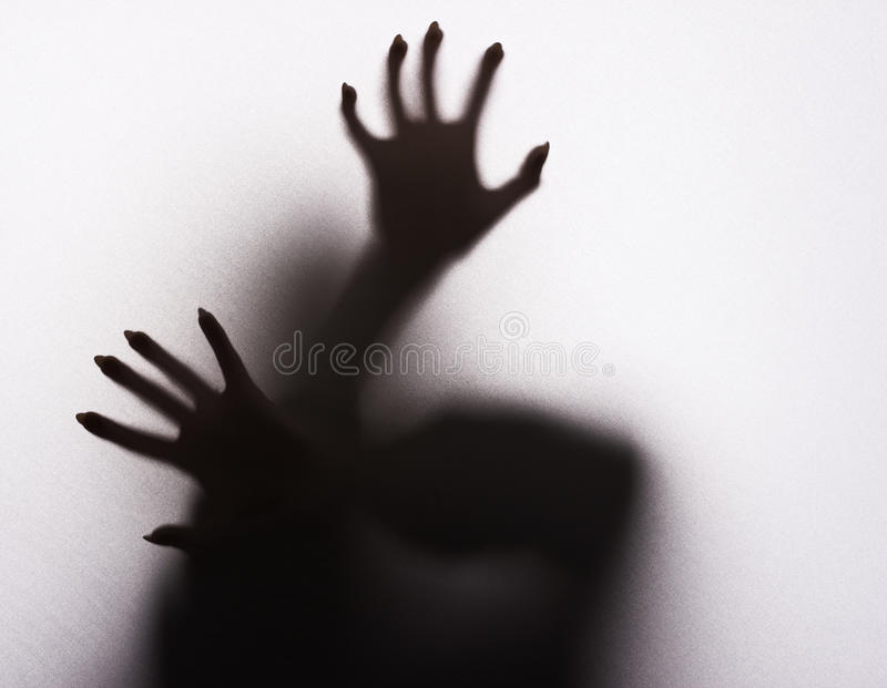 Scary female silhouette. On the fabric stock image