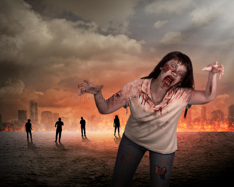 Scary female zombie with burning city background. Halloween concept stock image