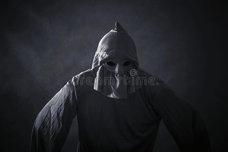 Scary figure in hooded cloak royalty free stock photos