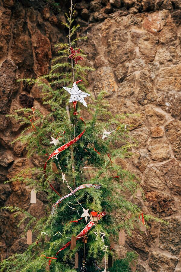 Free Scary Fragile Ugly Christmas Tree On A Stone Background. Stock Image - 198583941