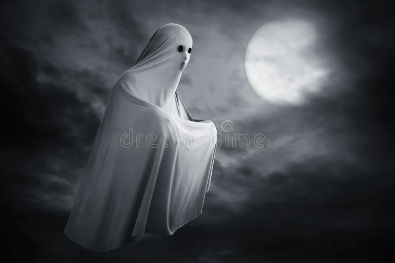 Scary ghost on dark background stock photography