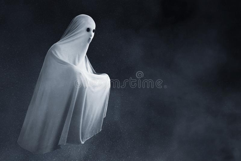 Scary ghost on dark background stock photo