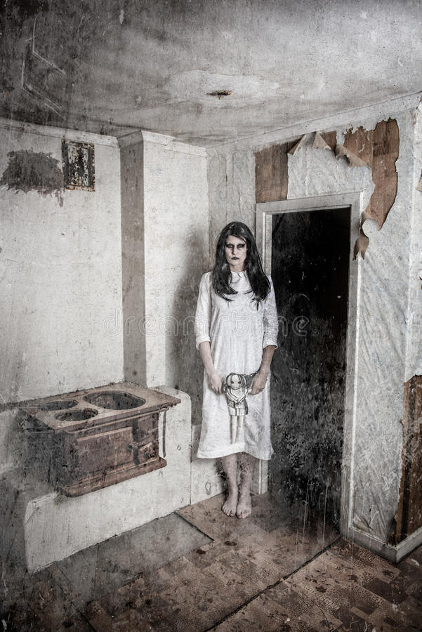 A scary ghost girl. A scary haunted ghost girl in a rural setting royalty free stock photos
