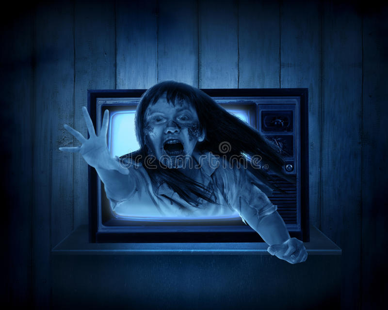Scary ghost out from old television. Halloween concept royalty free stock photos