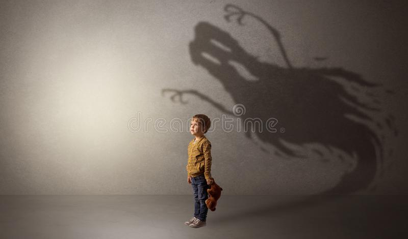 Scary ghost shadow behind kid stock photos