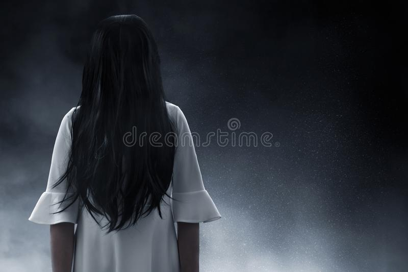 Scary ghost woman on dark background. S royalty free stock photography
