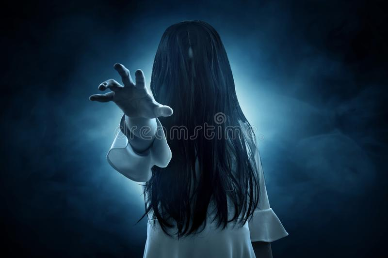 Scary ghost woman on dark background. S stock photography