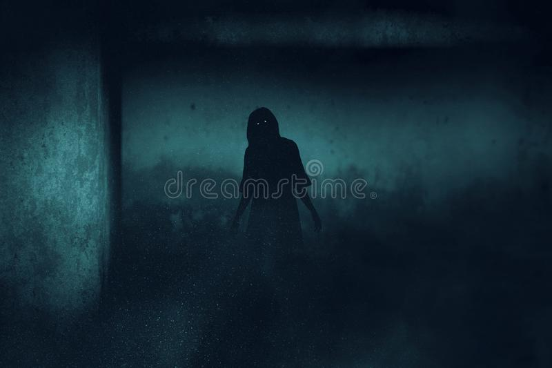 Scary ghost woman on dark background stock photography