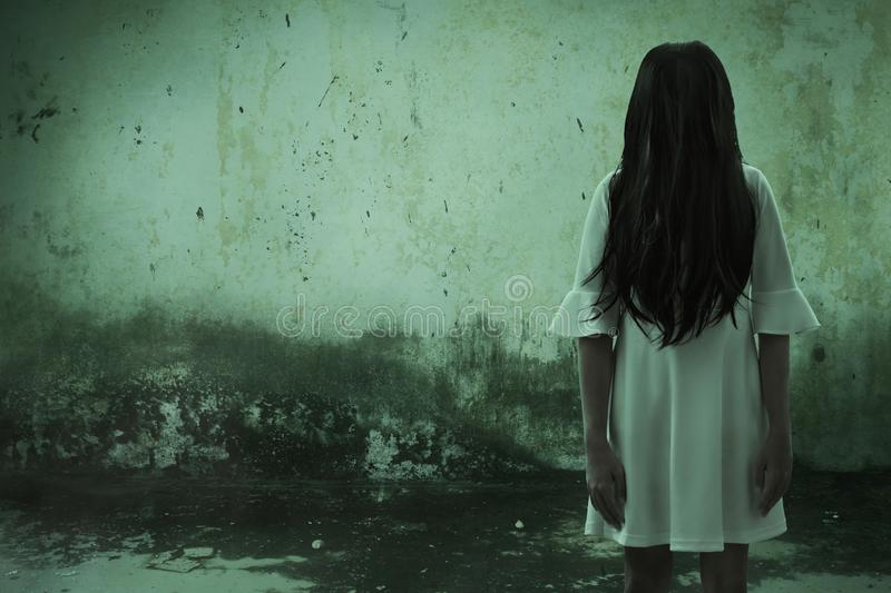 Scary ghost woman in haunted house stock photo