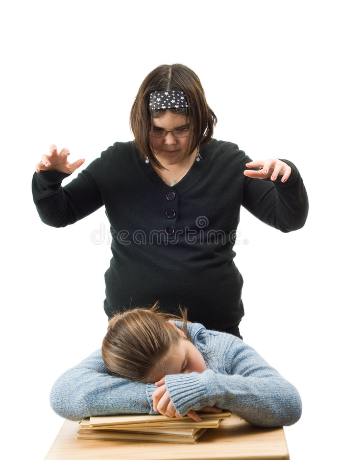 Scary Girl. A young girl about to scare her friend, isolated against a white background stock photography