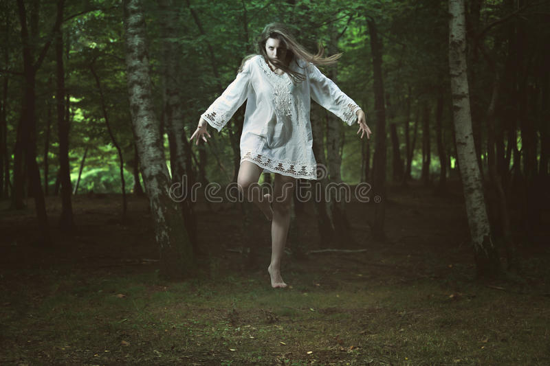 Scary girl with dark power stock images