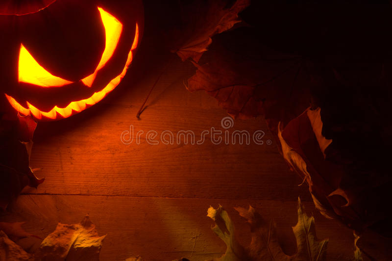 Scary halloween night with spooky evil face of jack o lantern in stock image