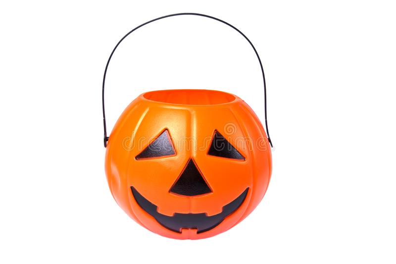 Scary Halloween plastic pumpkin isolated on white background. Child collecting candy Jack o`lantern basket , trick or treat royalty free stock photography