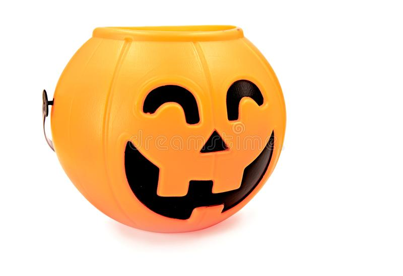 Scary halloween plastic pumpkin isolated on white with clipping path royalty free stock images