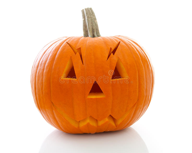 Scary halloween pumpkin with face. Isolated on white background stock images