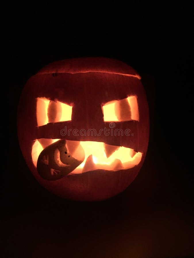 Scary Halloween pumpkin lantern. In the dark eating a potato royalty free stock photos