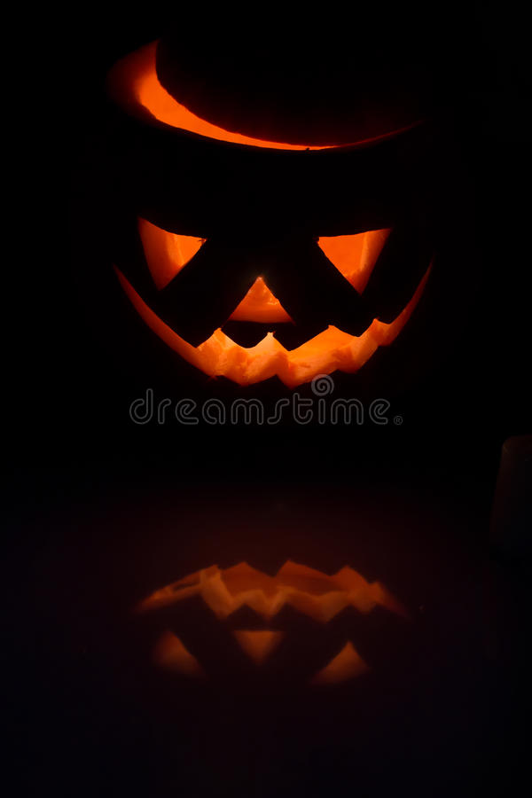 Scary Halloween pumpkin lantern ( jack-o'-lantern) with burning candle inside stock images