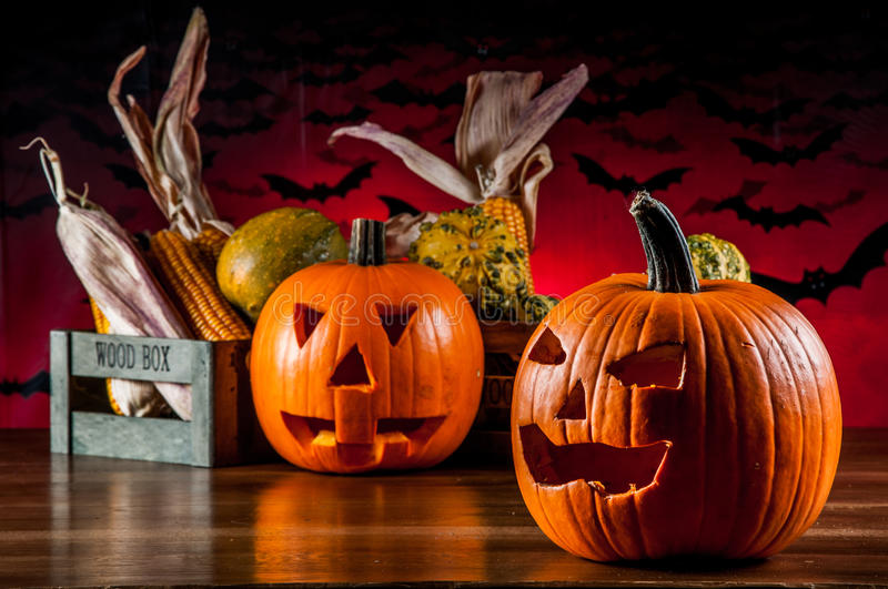 Scary halloween pumpkins. Colorful, ambient halloween concept of scary pumpkins stock photography