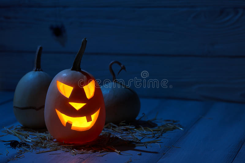 Scary halloween pumpkins in old barn stock image