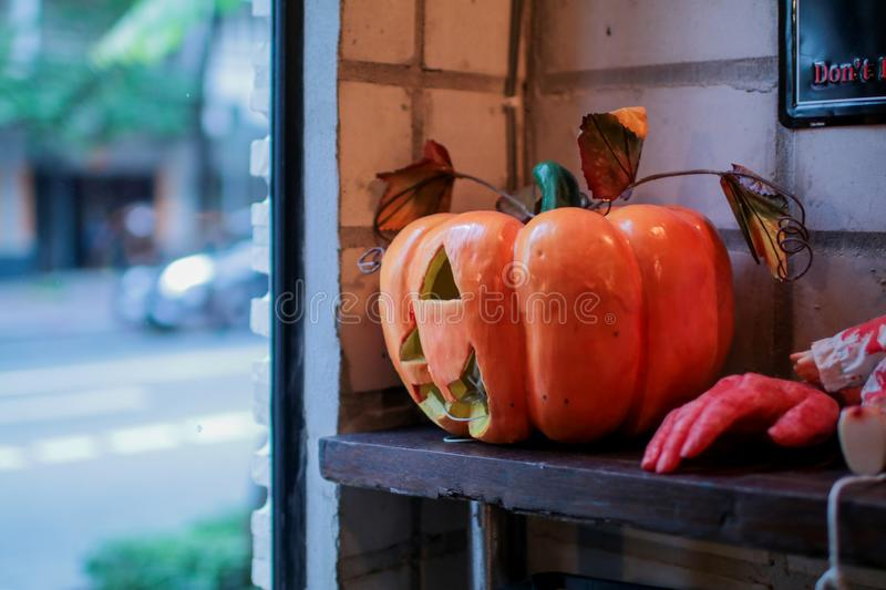 Scary halloween pumpkins on wooden planks, placed in front of window stock photography