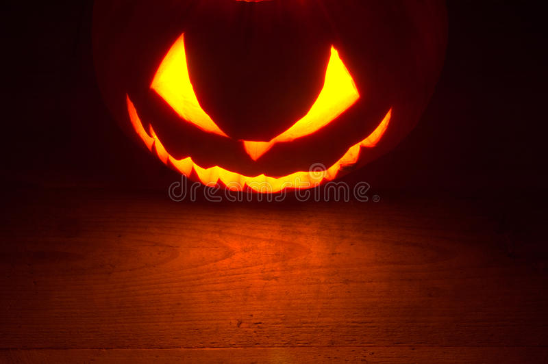 Scary halloween red background jack o lantern at the top. Spooky halloween dark red background with jack o lantern at the top royalty free stock images