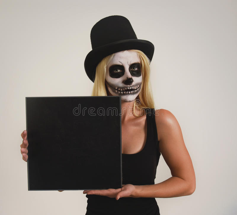 Scary Halloween Skeleton Girl with Blank Sign stock photo