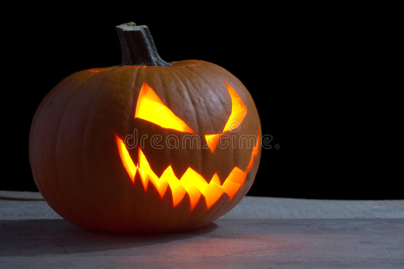 Scary halloween on wood with jack o lantern royalty free stock photography