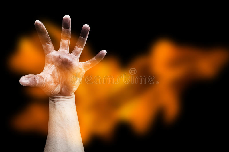 Scary hand with blaze. On black stock photos