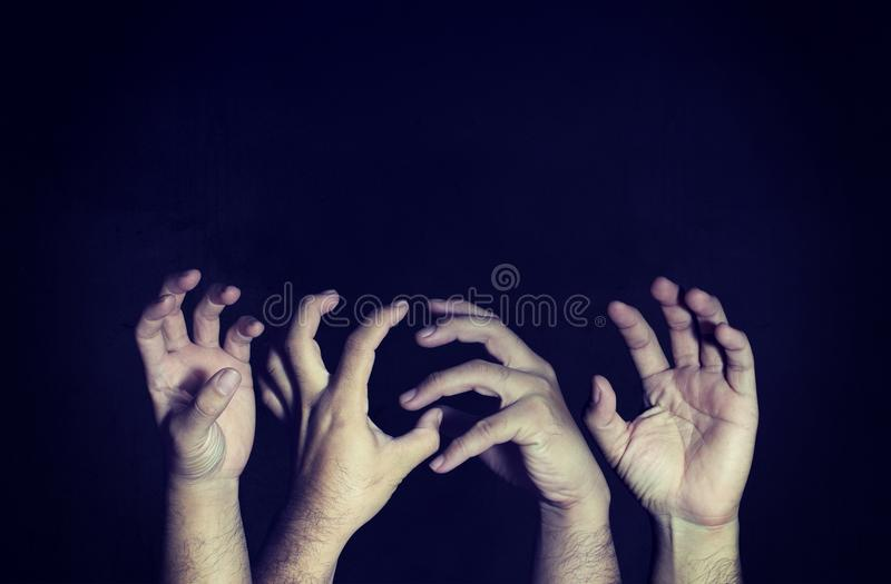 Scary horror hand on the darkness on a black background with cop royalty free stock images