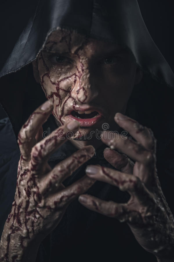 Scary horror man. Scarred bloody man screaming in agony and pain stock photography
