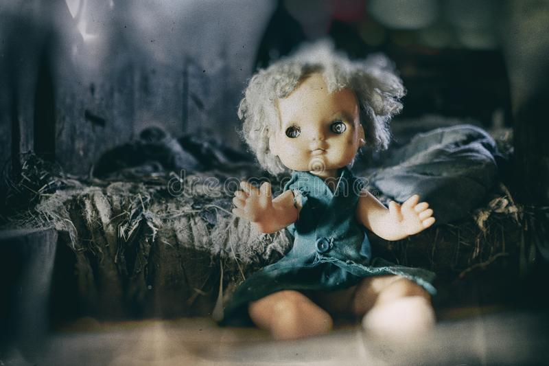 Scary horror plastic doll without eyes. Ghost mystic doll smiling. Scary horror plastic doll without eyes stock photography