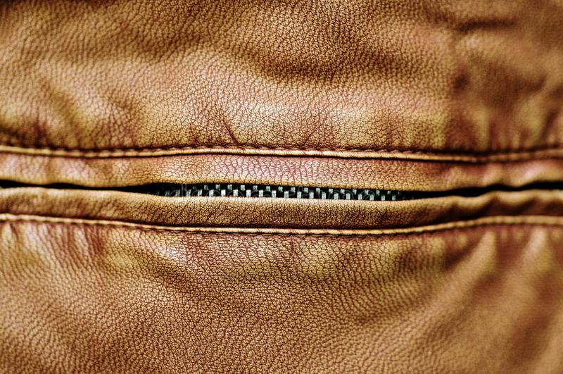 Scary leather mouth with metal zipper teeth stock photo