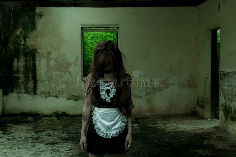 The Scary Maid ghost story. In haunted house stock images