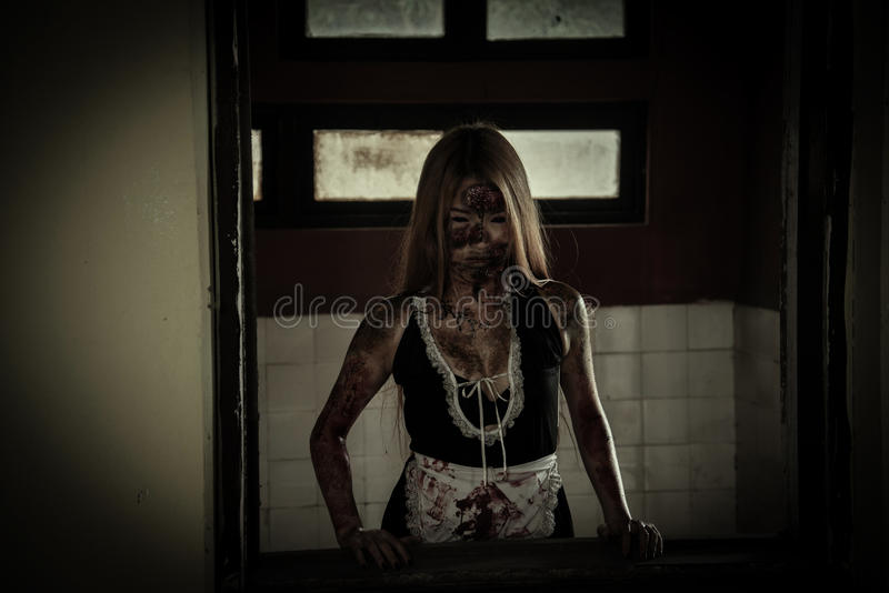 Scary Maid ghost story of a haunted house. Zombie girl in haunted house scary stock photo